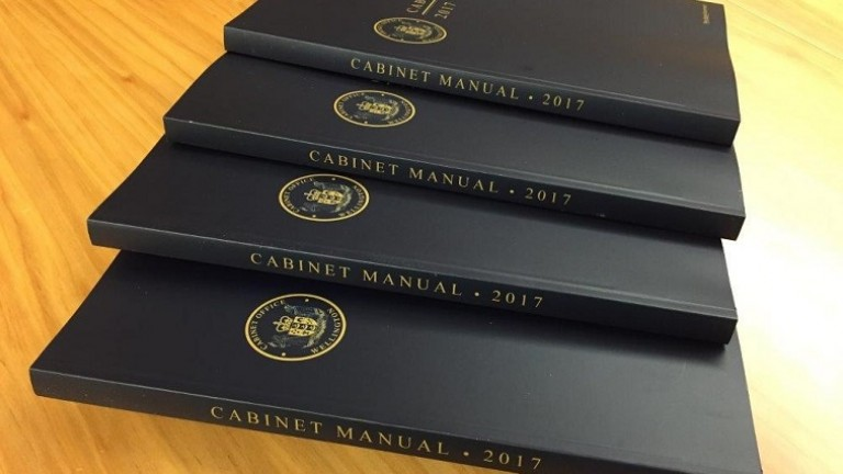 Copies of the Cabinet Manual 2017 edition on a table