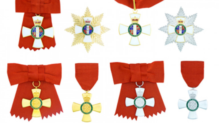 Composite of the full size insignia of the five levels of the New Zealand Order of Merit