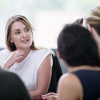 Woman talking with others in a meeting
