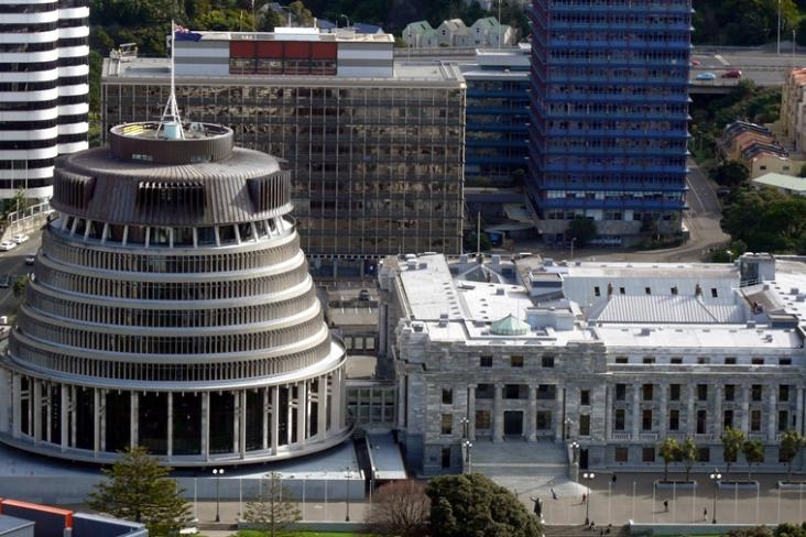 Aerial view of the Beehive and New Zealand Parliament building, with surrounding buildings.