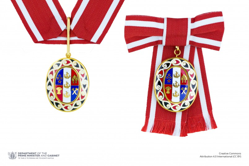 Badge of a Member of the Order of New Zealand (two badges shown side-by-side on neck ribbon and ribbon bow respectively)