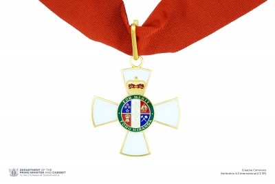 Insignia of a Companion of the New Zealand Order of Merit (on neck ribbon)