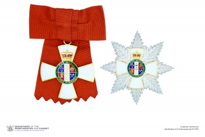 Insignia of a Dame Companion of the New Zealand Order of Merit (badge on ribbon bow and breast star)