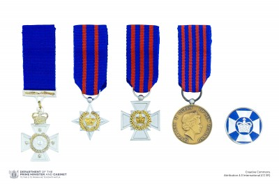 Composite image of the miniatures and lapel badges denoting the New Zealand Bravery Awards