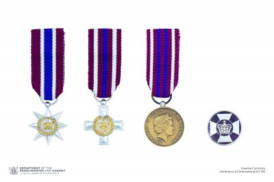 Composite image of the miniatures and lapel badges denoting the New Zealand Gallantry Awards