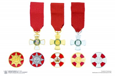 Composite image of the miniature insignia and lapel badges denoting the five levels of the New Zealand Order of Merit