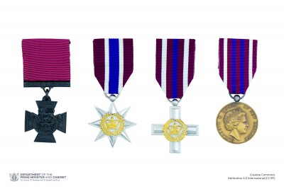 Composite image of the full-size New Zealand Gallantry Awards insignia on ribbons