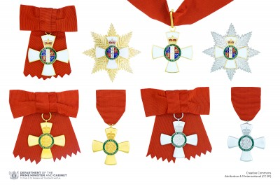 Composite of the full-size insignia of the five levels of the New Zealand Order of Merit